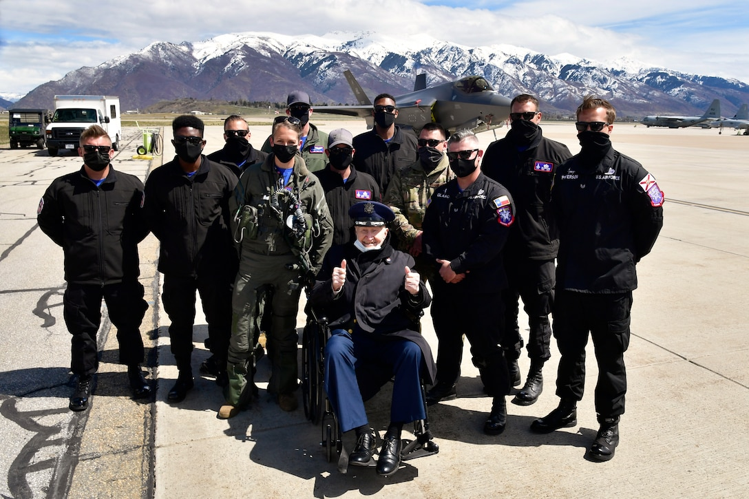 """Air Force Col. (Ret.) Gail Halvorsen, the """"Berlin Candy Bomber,"""" poses for a picture with the F-35A Lightning II Demonstration Team after a demo team practice session April 16, 2021, at Hill Air Force Base, Utah. Halvorsen and family members witnessed the F-35 demo and then visited with the demo pilot and team afterward. (U.S. Air Force photo by Todd Cromar)"""