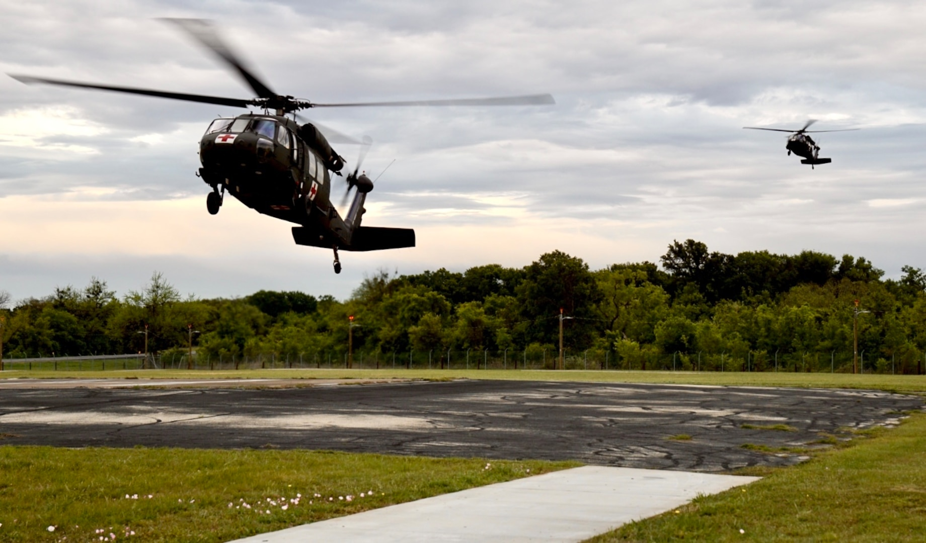 Task Force Phoenix UH-60 Black Hawk helicopters from G Company, 1st Battalion, 168th Aviation Regiment (General Support Aviation Battalion), land at North Fort Hood, Texas, April 17, 2021, during a medevac training mission that was part of a culminating training exercise.