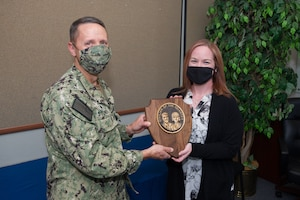 DAHLGREN, Va. (April 20, 2021) Center for Surface Combat Systems (CSCS) Commanding Officer, Capt. Dave Stoner, recognizes Ms. Cyndy Duscio, the information system security manager and cybersecurity workforce program manager for CSCS' chief information officer, N6, as headquarters' Civilian of the Quarter for the first quarter of 2021, at a socially-distanced awards ceremony onboard Naval Support Facility Dahlgren, Va.  (U.S. Navy photo by Michael Bova)
