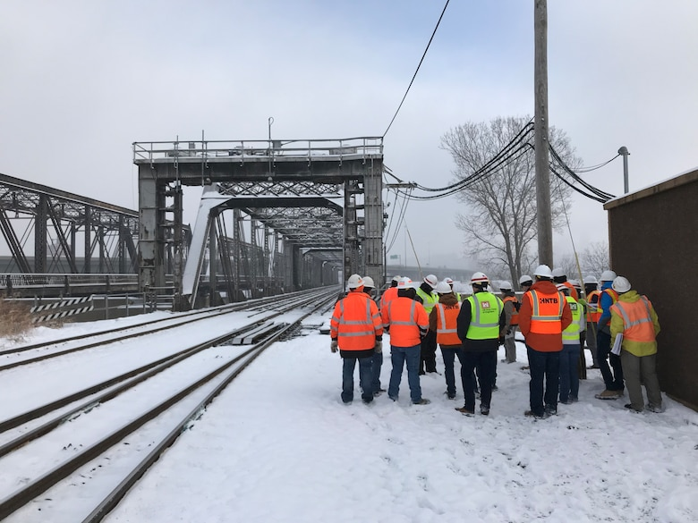 Personnel from Kansas City District, HNTB architecture firm, and the Union Pacific Railroad reviewing a closure structure along the Armourdale Levee Unit.