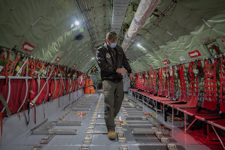 Airman walking in an aircraft.