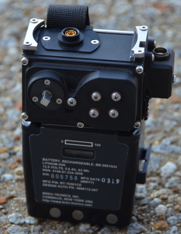 """The portable """"Surge Combat Survivor Evader Locator Tactical Charging Device"""" attaches to the CSEL radio's battery, as shown here, providing compatibility for four different charging methods. (Photo courtesy of Combat Power Solutions, LLC)"""