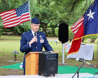 Col Andrew Camacho, 147th Attack Wing Commander, and Chief Master Sgt. Walter Zelezniak, 147th Attack Wing Command Chief, participate in an event honoring Lt. Col James M. Parker, Jr., a WWII veteran who is laid to rest in Livingston, TX, April 17, 2021
