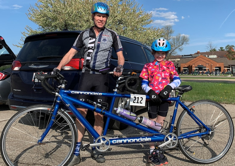 The youngest Blue Streak rider in the season opener April 13 was 7-year-old Etta Hudson of Tipp City. Etta was the stoker on a tandem bicycle behind her grandfather, Lt. Gen. (Ret.) Jack Hudson. (Contributed photo)