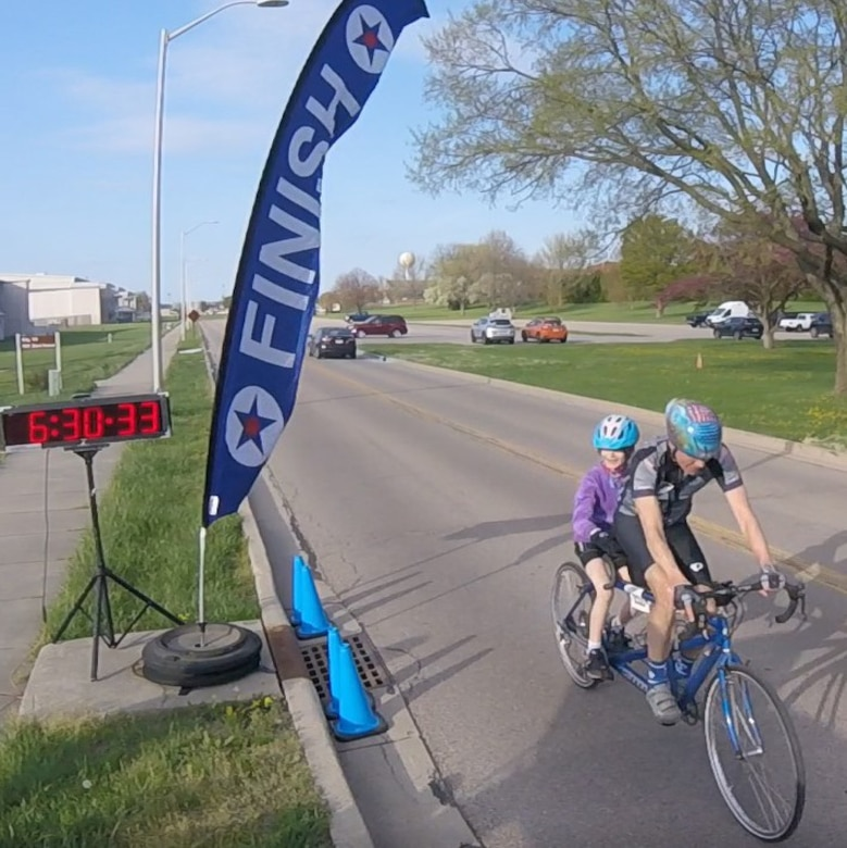Lt. Gen. (Ret.) Jack Hudson and his granddaughter, Etta, 7, cross the finish line in 30 minutes, 3 seconds April 13 during the 2021 Blue Streak Time Trial season opener at Wright-Patterson Air Force Base. (Contributed photo)