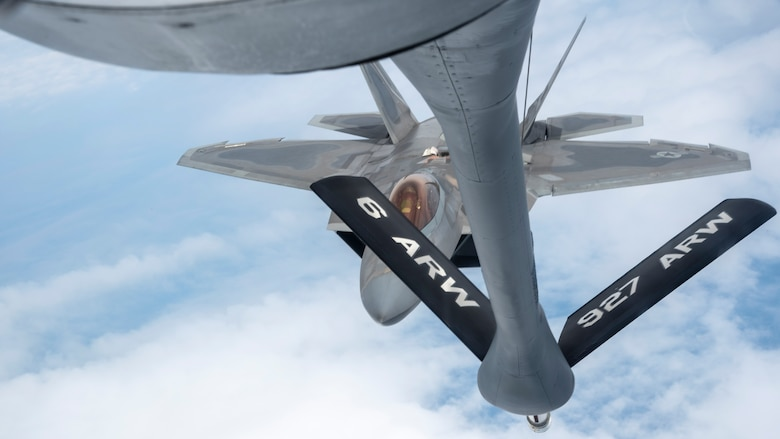"""U.S. Air Force Maj. Joshua """"Cabo"""" Gunderson, F-22 Raptor Demonstration Team commander, prepares to receive fuel from a MacDill Air Force Base, Fla., KC-135 Stratotanker, April 17, 2021."""