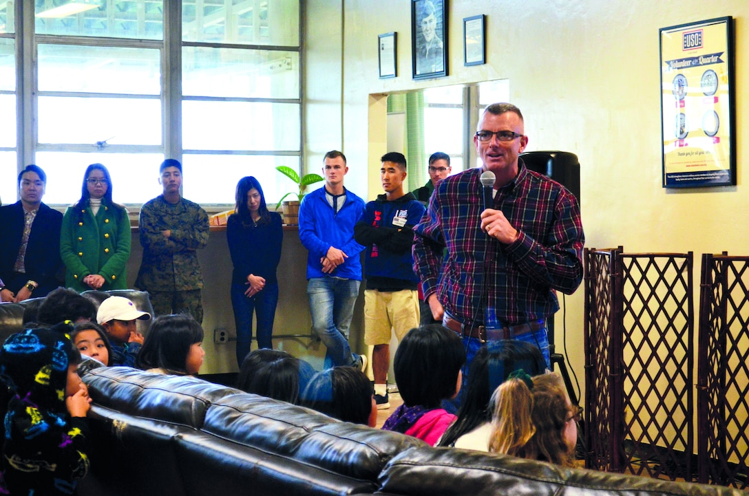 Col. Perry makes closing remarks in Japanese to the people from the local communities at the 38th Camp Schwab/USO Christmas Children's Day in Camp Schwab USO Dec. 7, 2019.