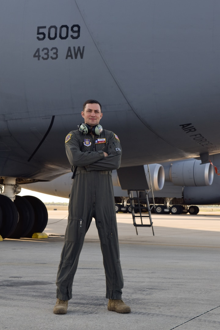 Master Sgt. Jason Henry, 733rd Training Squadron flight engineer instructor, stands in front of a C-5M Super Galaxy at Joint Base San Antonio-Lackland, Texas, March 25, 2021. Henry has served in various roles during his 18 years of service in the Air Force.