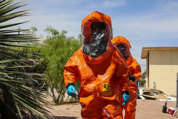 Sgts. Chaz Rapp and Rjhun Rimon with the 92nd Civil Support Team, Nevada National Guard, search for hazardous materials in level-A fully encapsulated chemical entry suits during training scenarios for Exercise Desert Torch, April 20, 2021, in Las Vegas.