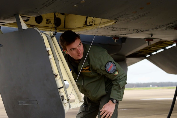 Photo of Airman standing outside a B-52