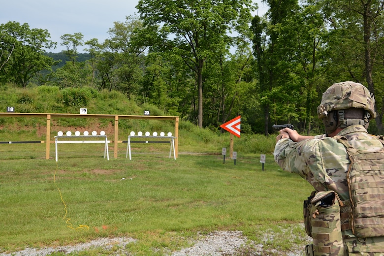 Staff Sgt. Duane Koons, assigned to 3rd Battalion, 166th Training Regiment, Pennsylvania National Guard takes aim during a pistol event at the Pennsylvania National Guard Adjutant General's Combined Arms Match June 2 at Fort Indiantown Gap. (U.S. Army National Guard photo by Lt. Col. Angela King-Sweigart)