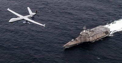 n MQ-9 Sea Guardian unmanned maritime surveillance aircraft system flies over Independence-variant littoral combat ship USS Coronado (LCS 4) during U.S. Pacific Fleet's Unmanned Systems Integrated Battle Problem (UxS IBP) 21.