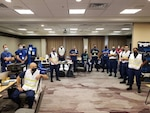 Members of the Incident Command Post for Marine Safety Unit Port Arthur participate in a briefing in Tyler, Texas, August 27, 2020, several hours after Hurricane Laura made landfall. The team is primarily focused on reconstituting the maritime transportation system and addressing any maritime pollution concerns. (U.S. Coast Guard photo by Senior Chief Petty Officer Christie Hamilton)