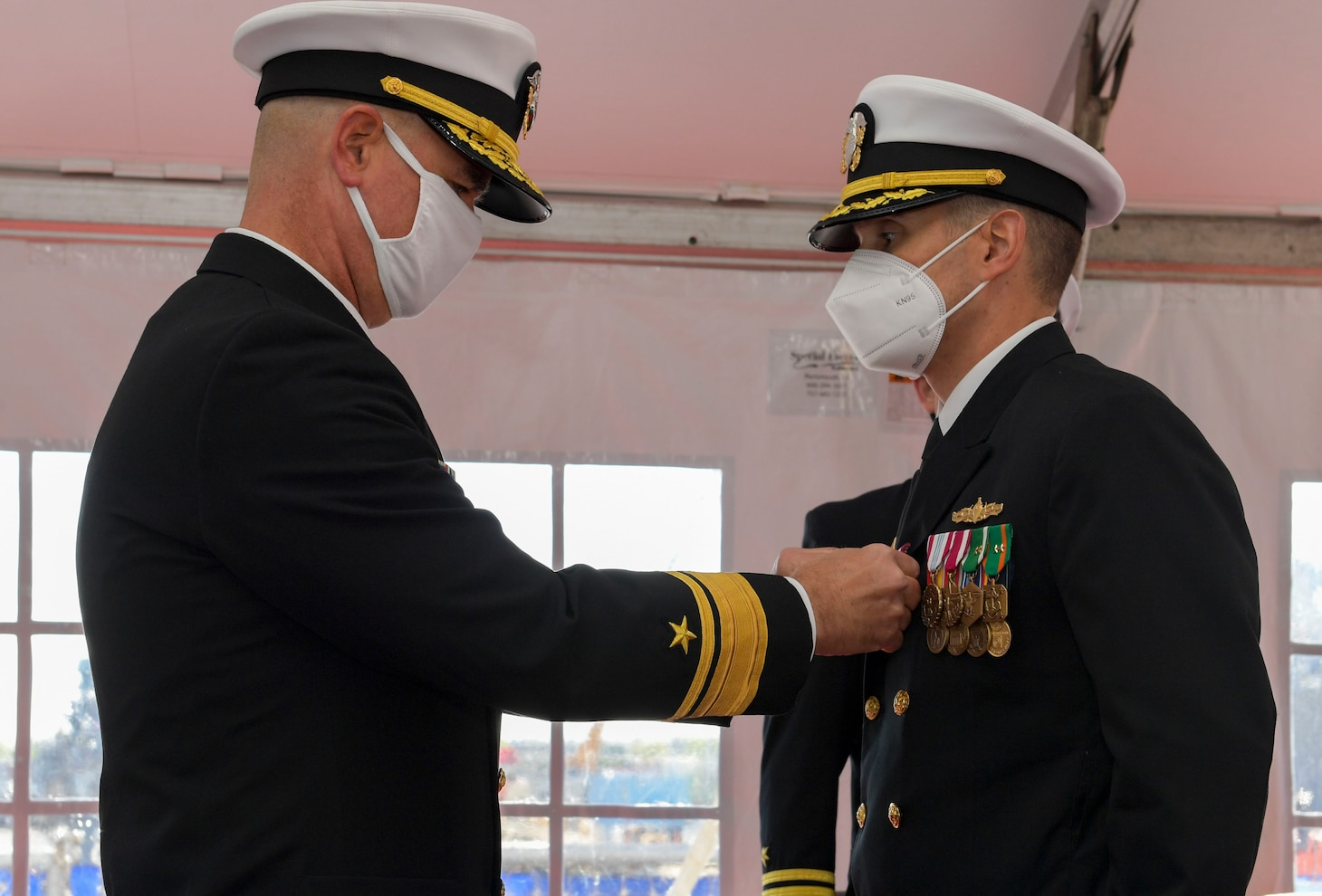 NAVAL STATION NORFOLK – Rear Adm. Brendan McLane, commander, Surface Force Atlantic, awards Cmdr. Matthew Erdner with the Meritorious Service medal during a change of command ceremony on board the Arleigh Burke-class destroyer USS Mason (DDG 87). During the ceremony, Cmdr. Stephen Valerio relieved Erdner of command following at 18-month tour as commanding officer. (U.S. Navy photo by Mass Communication Specialist 2nd Class Jacob Milham/Released)