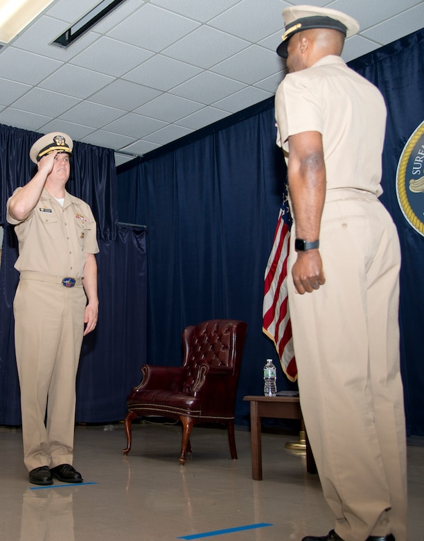 NEWPORT, R.I. (April 22, 2021) Capt. Christopher Alexander (left), salutes Capt. Alexis Walker as he relinquishes command of Surface Warfare Schools Command (SWSC) during a change of command ceremony at Naval Station (NAVSTA) Newport R.I., April 22, 2021. SWSC prepares sea bound Sailors to serve on surface combatants as officers, enlisted engineers, and enlisted navigation professionals to fulfill the Navy's mission to maintain global maritime superiority. (U.S. Navy photo by Mass Communication Specialist 2nd Class Derien C. Luce)
