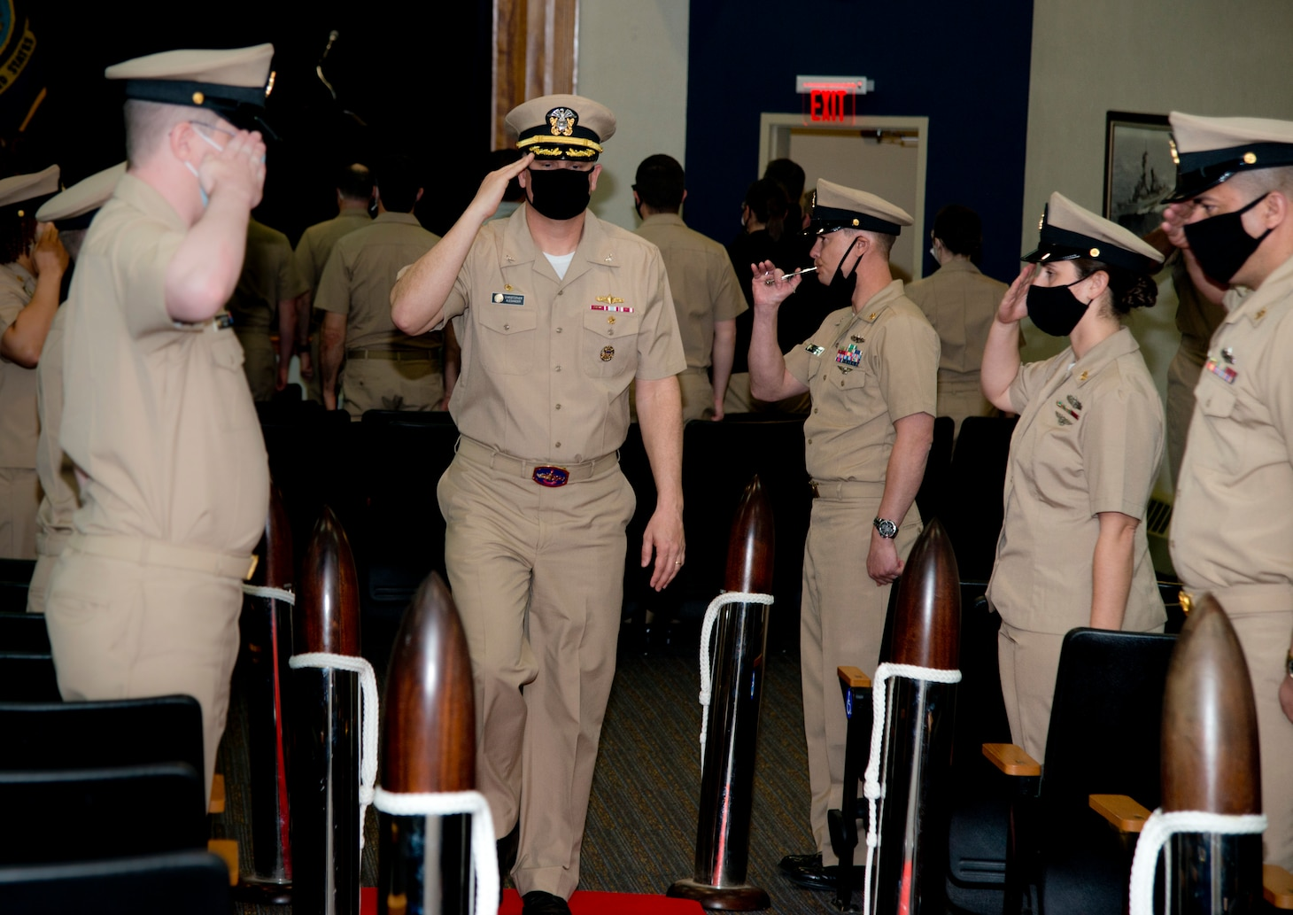 NEWPORT, R.I. (April 22, 2021) Capt. Christopher Alexander passes through sideboys during the Surface Warfare Schools Command  (SWSC) change of command ceremony at Naval Station (NAVSTA) Newport R.I., April 22, 2021. During the ceremony, Alexander was relieved by Capt. Alexis Walker as SWSC's commanding officer. (U.S. Navy photo by Mass Communication Specialist 2nd Class Derien C. Luce)