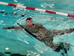 soldier in water doing water survival training