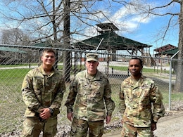 two soldiers and command sergeant major