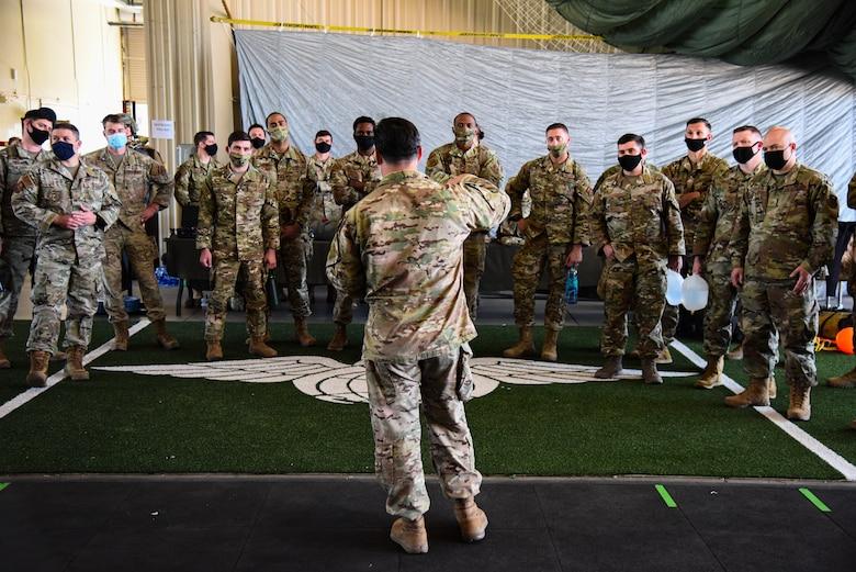 A photo of an airmen briefing a group of airmen