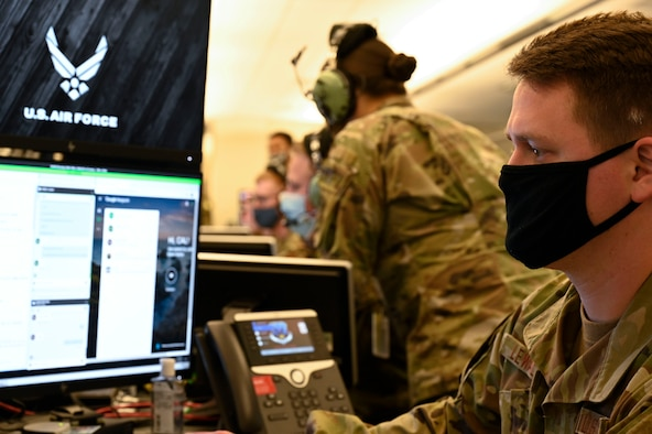 "A member from the 727th Expeditionary Air Control Squadron (EACS) ""Kingpin"" works at his station, at Shaw Air Force Base, South Carolina, April 21, 2021. Kingpin is a tactical command and control unit that serves as the lead control and reporting center and directly provides the Combined Air Operations Center with a common air picture, enabling the completion of air operations across the US Central Command area of responsibility. The 727th EACS repositioned from Al Dhafra Air Base and began full operations April 20 from Shaw AFB. (U.S. Air Force photo by Tech. Sgt. E'Lysia A. Wray)"