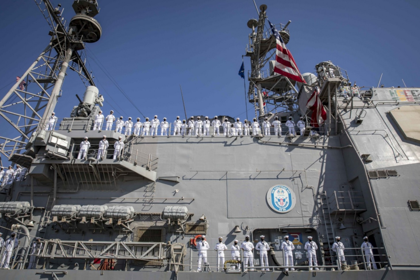 Sailors assigned to the guided-missile cruiser USS Philippine Sea (CG 58) man the rails as the ship pulls into Naval Station Mayport, Fla. Philippine Sea returned from a 10-month deployment to the U.S. 2nd, 5th, and 6th Fleet areas of operation.
