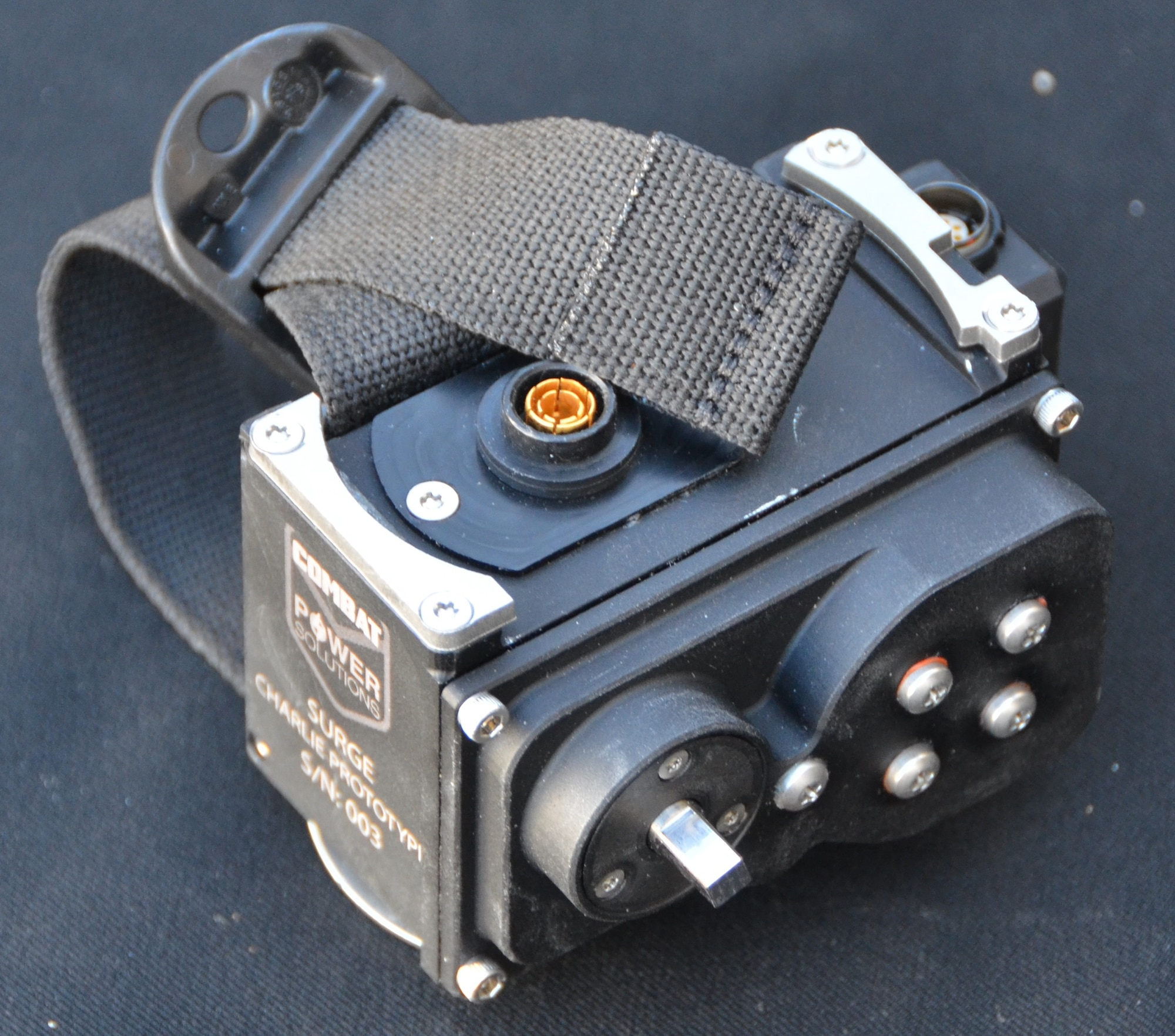 The 711 Human Performance Wing's Battlefield Air Targeting Man-Aided Knowledge team aided contractor Combat Power Solutions' Small Business Innovation Research project to develop a much-needed warfighter capability: a portable charging device (shown by itself here in its final prototype) for a radio that is critical during combat survival. (Photo courtesy of Combat Power Solutions, LLC)
