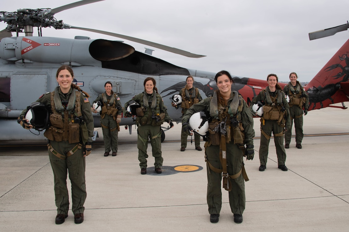 Navy pilots and aircrew pose for a photo before taking off on the first all-female crew MH-60R Sea Hawk training flight.