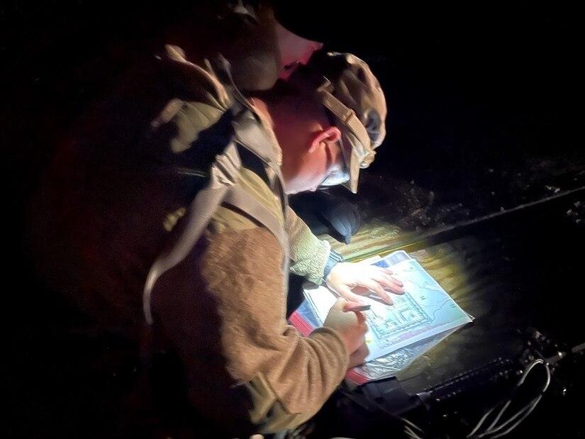soldier plots night navigation points