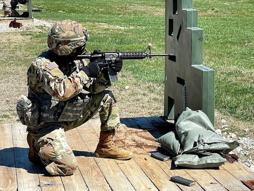 soldier fires M16