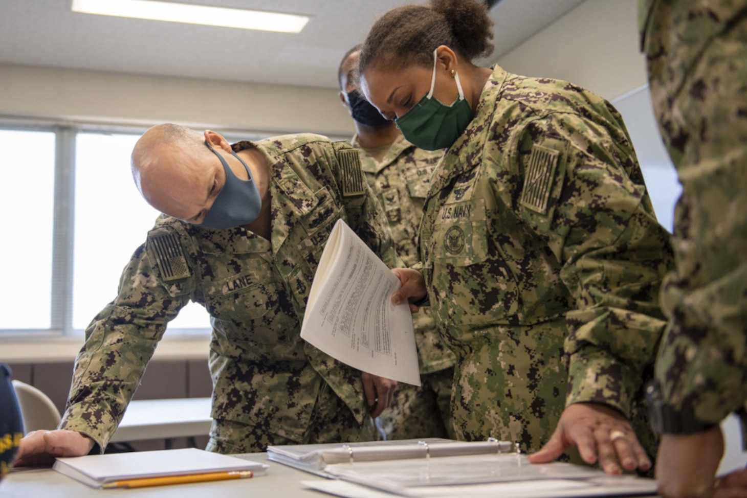 Senior Chief Navy Counselor Scott Lane, left, from Malvern, Ohio and Chief Navy Counselor Anita Felix, right, from Houston, both assigned to the forward-deployed amphibious assault ship USS America (LHA 6), proctor the Armed Services Vocational Aptitude Battery in the Fleet Activities Sasebo Community Educational Center. America, lead ship of the America Amphibious Ready Group, along with the 31st Marine Expeditionary Unit, is operating in the U.S. 7th Fleet area of responsibility to enhance interoperability with allies and partners and serve as a ready response force to defend peace and stability in the Indo-Pacific region