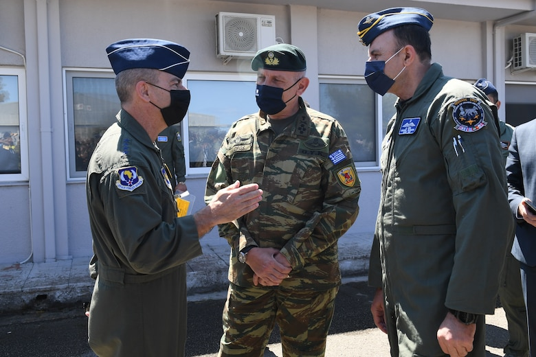 U.S. Air Force Gen. Jeff Harrigian, U.S. Air Forces in Europe and Air Forces Africa commander, left, speaks with Hellenic Air Force Gen. Konstantinos Floros, Chief of Hellenic National Defense General Staff, center, and Hellenic Air Force Lt. Gen. George Blioumis, Chief of Hellenic Air Force General Staff, right, during INIOCHOS 21 at Andravida Air Base, Greece, April 20, 2021. INIOCHOS 21 is an annual exercise in Greece which provides participants the opportunity to develop capabilities in planning and conducting complex air operations in a multinational joint forces environment. The exercise provides advanced and realistic aircrew training to strengthen interoperability of allied and partner air forces. (U.S. Air Force photo by Staff Sgt. Valerie Halbert)