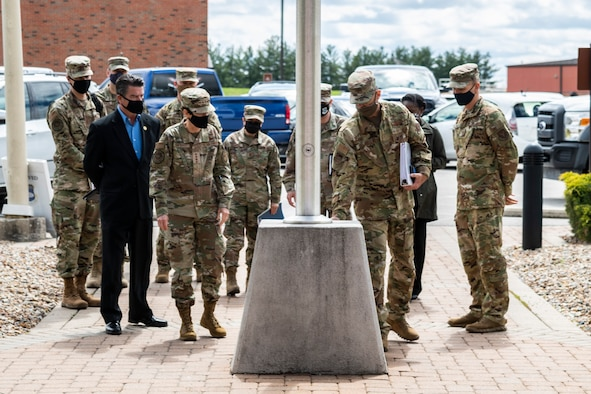 U.S. Air Force Gen. Jacqueline Van Ovost, Air Mobility Command commander, admires the Tech. Sgt. Anthony Campbell memorial at the 932nd Airlift Wing main entrance, at Scott Air Force Base, Illinois, April 10, 2021. Van Ovost visited with Airmen from across the Wing to highlight the importance of their job and the AMC mission. (U.S. Air Force photo by Senior Airman Brooke Spenner)