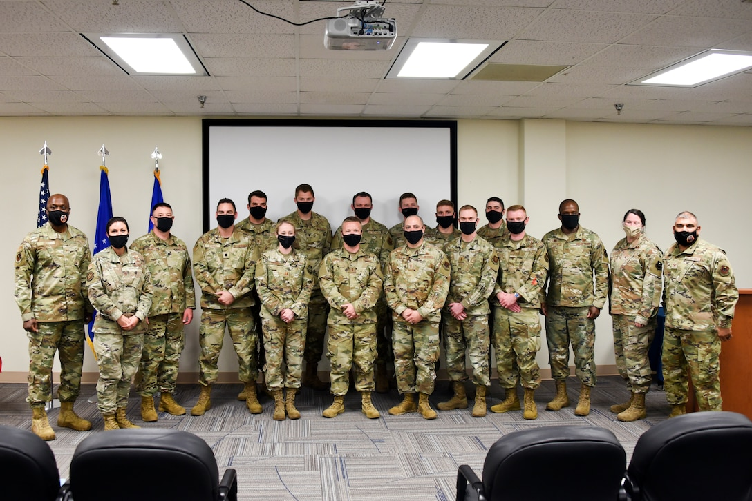 Wing, group and squadron level leadership pose for a photo with the newest graduates of the Aircraft Maintenance Officers Course at Sheppard Air Force Base, Texas, April 22, 2021