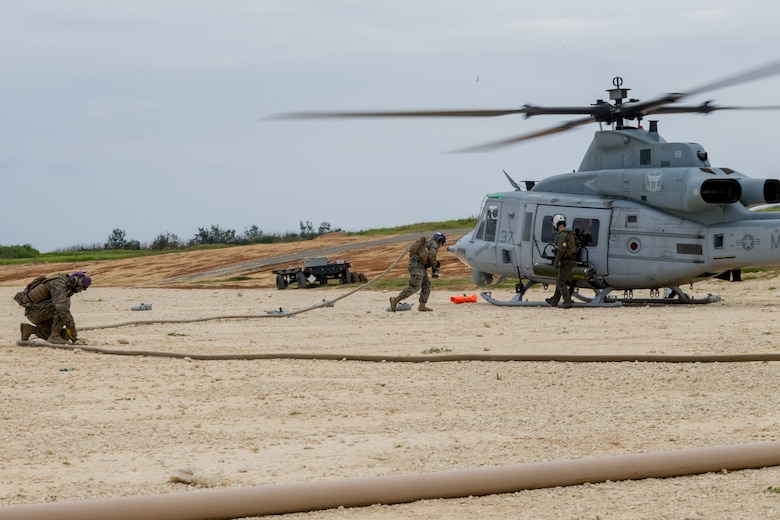 U.S. Marines prepare to refuel a UH-1Y Venom helicopter during a forward arming and refueling point training event as part of a Marine Corps combat readiness evaluation held by MWSS-172 at the Ie Shima training facility, Okinawa, Japan, April 15.