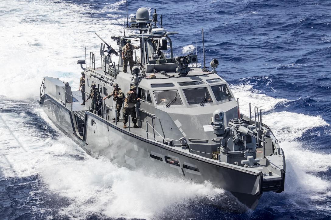 U.S. Sailors pull up alongside dock-landing ship USS Ashland (LSD 48) during a refueling operation in the Philippine Sea, Feb. 25.