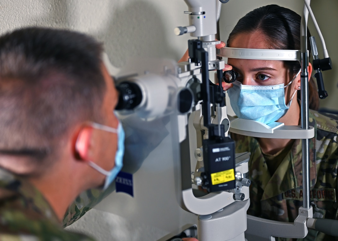 U.S. Air Force Capt. Paul Brown, 17th Medical Group optometry element chief, examines an Airman's eye at the Ross Clinic on Goodfellow Air Force Base, Texas, April 19, 2021. Brown served as the sole optometrist on base.  (U.S. Air Force photo by Airman 1st Class Michael Bowman)