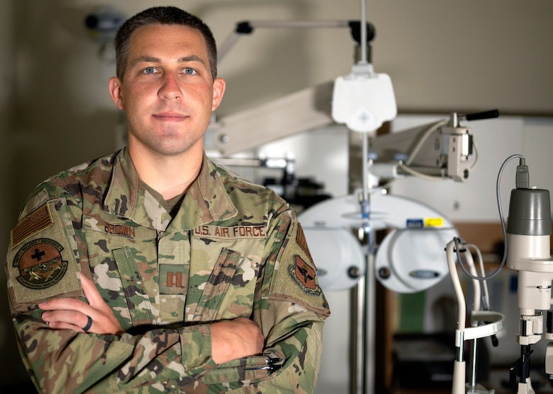 U.S. Air Force Capt. Paul Brown, 17th Medical Group optometry element chief, poses in front of his equipment at the Ross Clinic on Goodfellow Air Force Base, Texas, April 19, 2021. Brown serviced more than a thousand Goodfellow community members as the sole optometrist at the 17th MDG.  (U.S. Air Force photo by Airman 1st Class Michael Bowman)