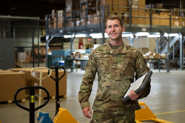 Airman 1st Class Orion Jones, 341st Logistics Readiness Squadron vehicle operator, poses for a photo in the 341st Logistics Readiness Squadron cargo hangar April 12, 2021, on Malmstrom Air Force Base, Mont.