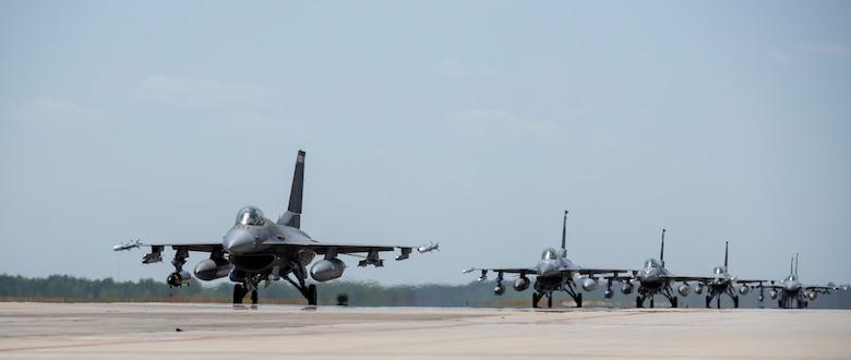 A photo of jets on a flightline.