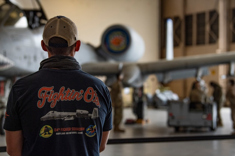 A photo of a pilot watching a competition