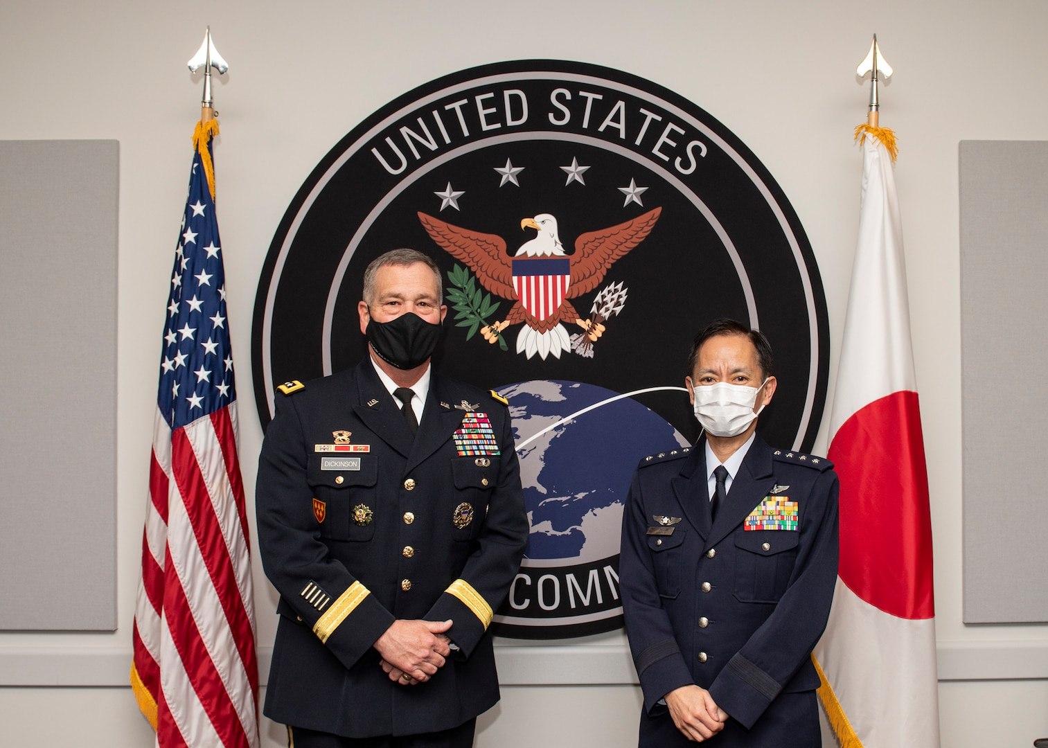 Japanese and American military officers pose for group photo