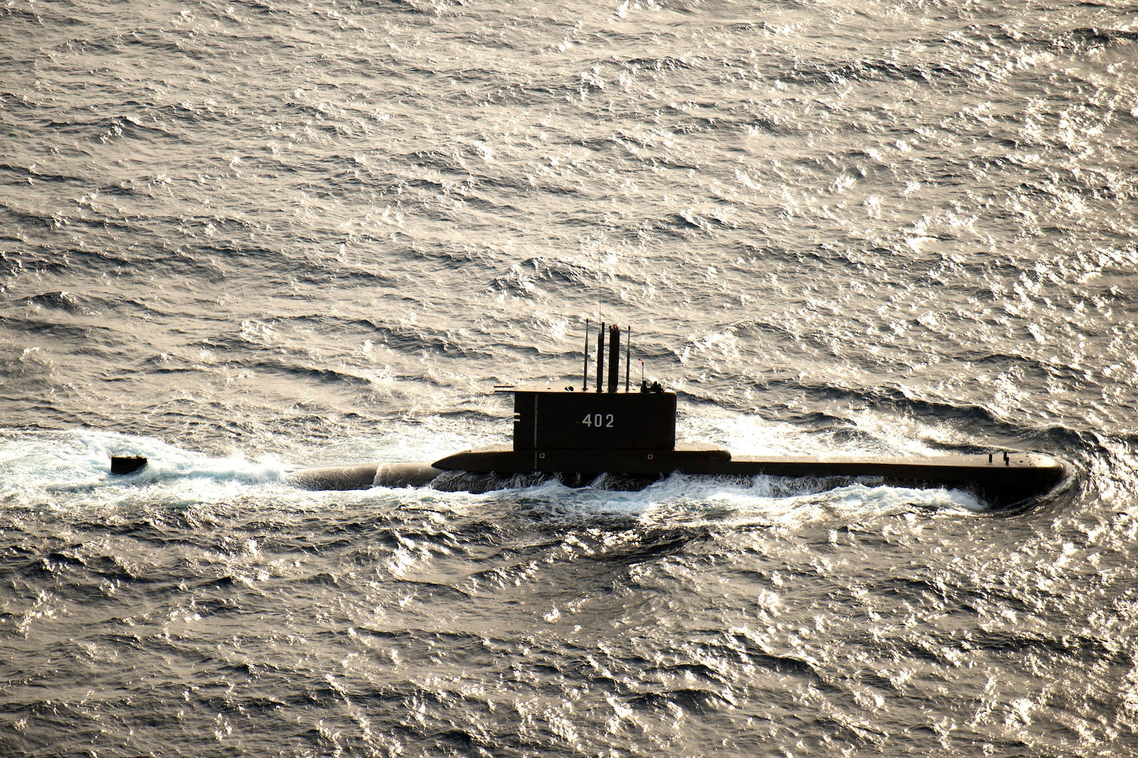 A submarine moves through the water.