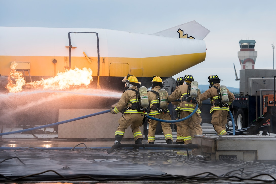 Firefighters from the 167th Airlift Wing, Martinsburg, W.Va., respond to a simulated aircraft fire as part of their Federal Aviation Administration Part 139 Live Fire Training, Oct. 14, 2018. The West Virginia State Fire Academy provided an aircraft fire simulator for the annual training event.