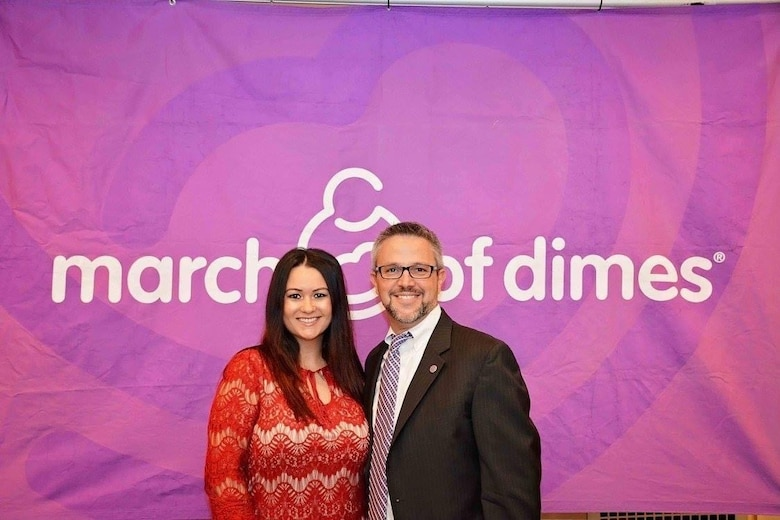 U.S. Air Force Master Sgt. Jessica Roy, 103rd Security Forces Squadron S2 intelligence and investigations superintendent and antiterrorism program manager, and Marc Spencer at the 2016 March of Dimes Signature Chef's Auction at The Bushnell Performing Arts Center in Hartford, Connecticut. Roy and Spencer both had infant sons pass away after being born prematurely and have dedicated the following years to advocacy work with the March of Dimes organization. (Courtesy photo)