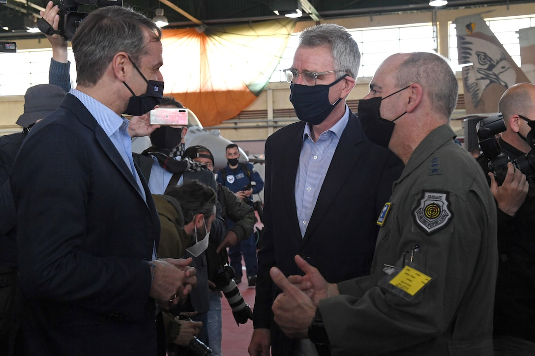 U.S. Air Force Gen. Jeff Harrigian, U.S. Air Forces in Europe and Air Forces Africa commander, and Geoffrey Pyatt, U.S. Ambassador to the Hellenic Republic, meet with Kyriakos Mitsotakis, Prime Minister of Greece during INIOCHOS 21 at Andravida Air Base, Greece, April 20, 2021. INIOCHOS 21 is an annual exercise in Greece which provides participants the opportunity to develop capabilities in planning and conducting complex air operations in a multinational joint forces environment. Along with Greek and U.S. participants, Canada, Cyprus, Israel, Slovenia, Spain and the United Arab Emirates are also supporting the exercise. (U.S. Air Force photo by Staff Sgt. Valerie Halbert)