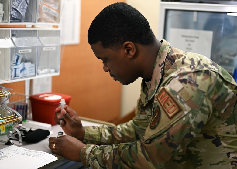 U.S. Air Force Senior Airman Micah Savage, 17th Medical Group immunizations technician, demonstrates how vaccines are prepared at the Ross Clinic on Goodfellow Air Force Base Texas, April 19, 2021. Savage performed his duties as an immunization technician to ensure the health and welfare of all Goodfellow personnel. (U.S. Air Force photo by Airman 1st Class Michael Bowman)