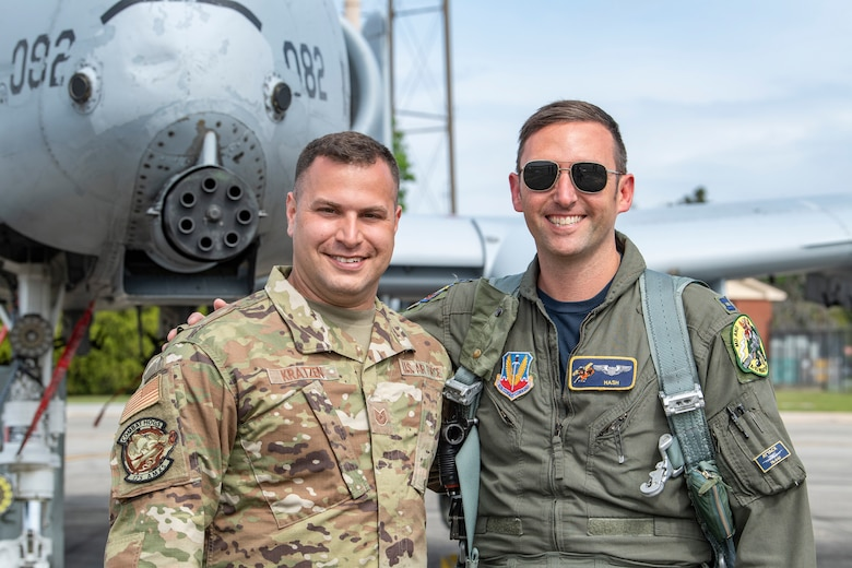 A photo of two Airmen posing during a competition