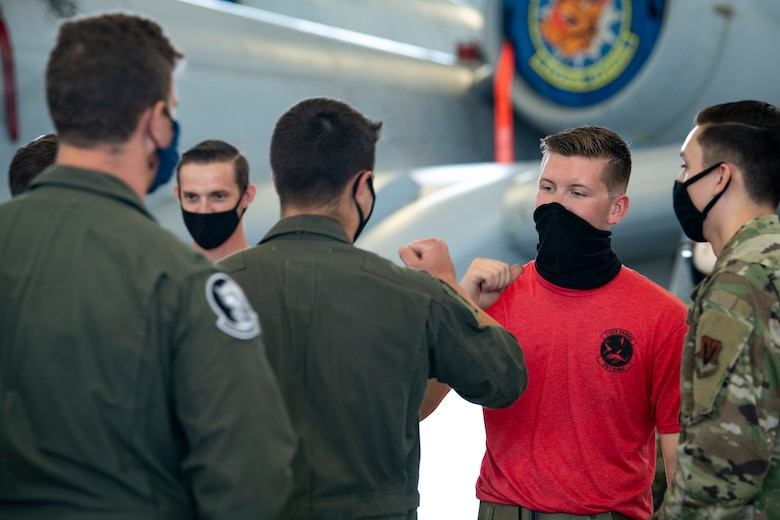 A photo of Airmen bumping fists after a competition