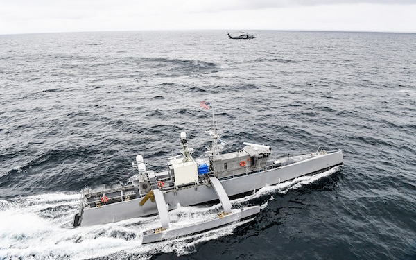 A Seahawk medium displacement unmanned surface vessel and an MH-60R Sea Hawk helicopter from Helicopter Maritime Strike Squadron (HSM) 73 participate in U.S. Pacific Fleet's Unmanned Systems Integrated Battle Problem (UxS IBP) 21, April 21.