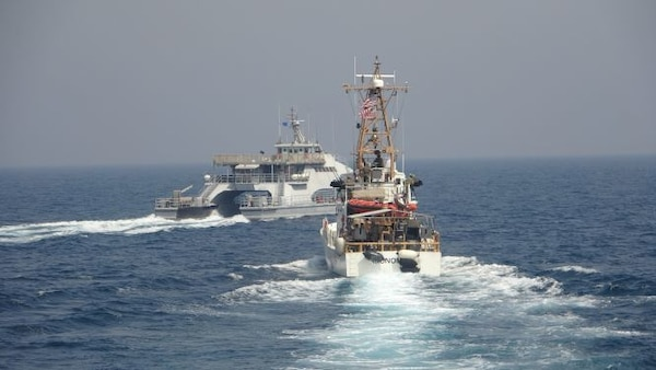 Iran's Islamic Revolutionary Guard Corps Navy (IRGCN) Harth 55, left, conducted an unsafe and unprofessional action by crossing the bow of the Coast Guard patrol boat USCGC Monomoy (WPB 1326), right, as the U.S. vessel was conducting a routine maritime security patrol in international waters of the southern Arabian Gulf, Apr. 2.
